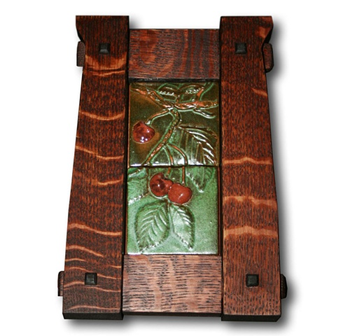 Hand-carved ceramic tile plaque featuring an image of sweet cherries from the shores of Montana's Flathead Lake