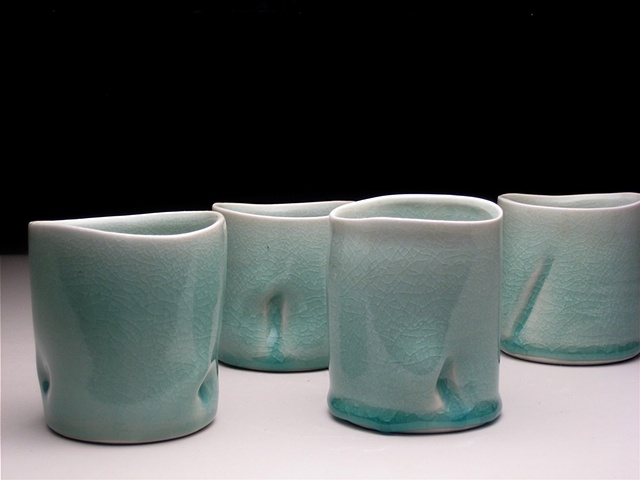 wheel thrown and altered celadon cups
