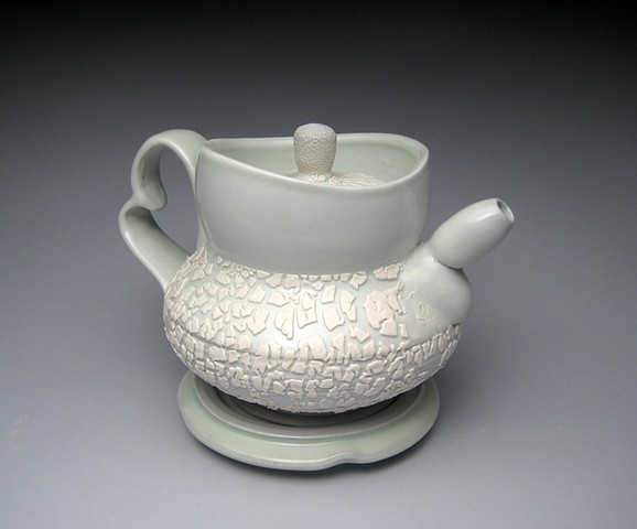 thrown and altered porcelain, celadon glaze, white crawl glaze, teapot,