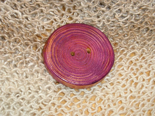 This Round Purple Hand Cut Wood button