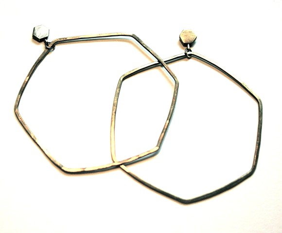 hoop earring made from oxidized brass with silver post by Jennifer Bennett