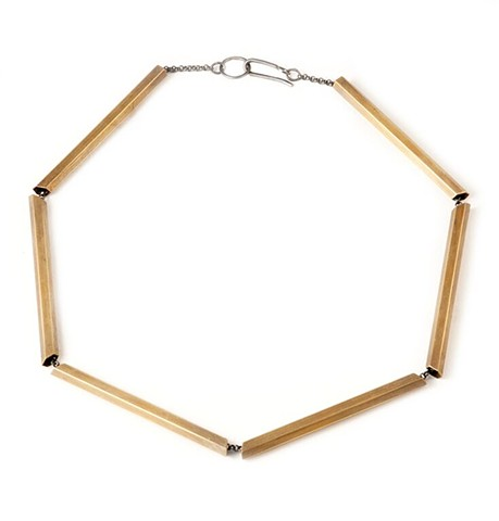 Modern tube necklace made from brass hexagon tubes and silver chain