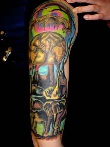 salvador dali swirls tattoo by tatupaul