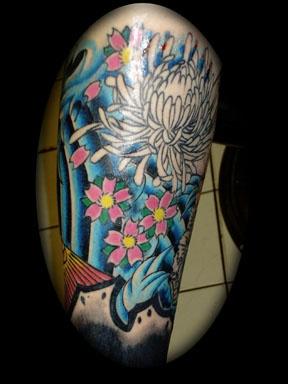 japanese waves tattoo by tatupaul
