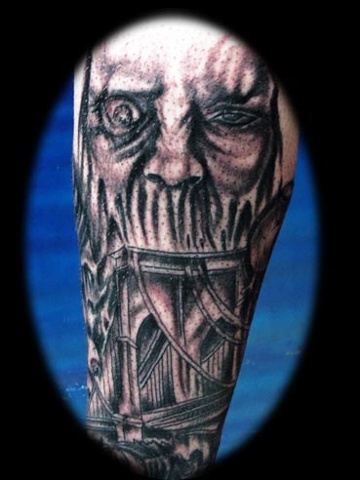 evil face tattoo by tatupaul.com