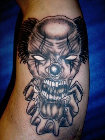 clown tattoo by tatupaul