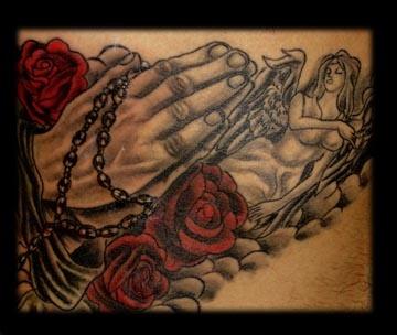 praying hands tattoo by tatupaul.com