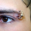 eye brow piercing by tatupaul