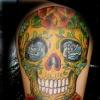 dia de los muerto skull mex tattoo by tatupaul