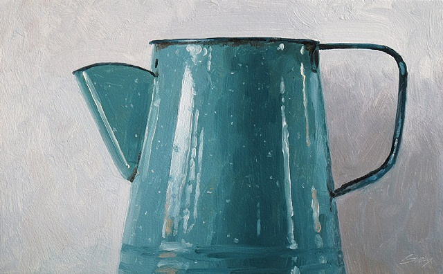 Blue enamel coffee pot on white background.