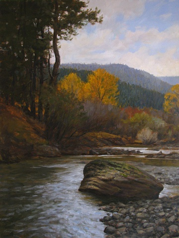 Fall landscape, evergreen forest with yellow cottonwoods, stream and boulder.