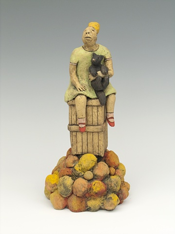girl with cat sitting on fruit crate ceramic sculpture by sara swink