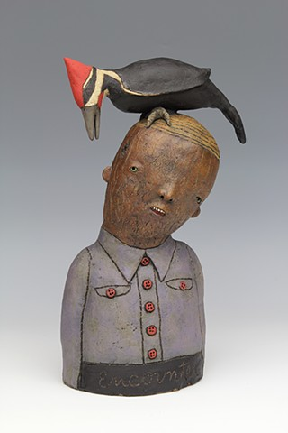 ceramic sculpture with pileated woodpecker bird by sara swink