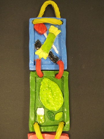 Middle School student-made clay hanging sculpture.