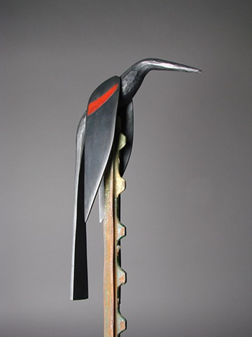 Forged steel Redwing Blackbird perched on a fence post.