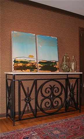 earth tones with metallic sky on raw canvas