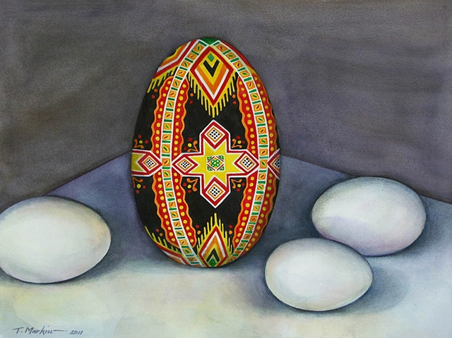 watercolor painting of a large Ukrainian Easter egg (pysanka) surrounded by smaller white eggs