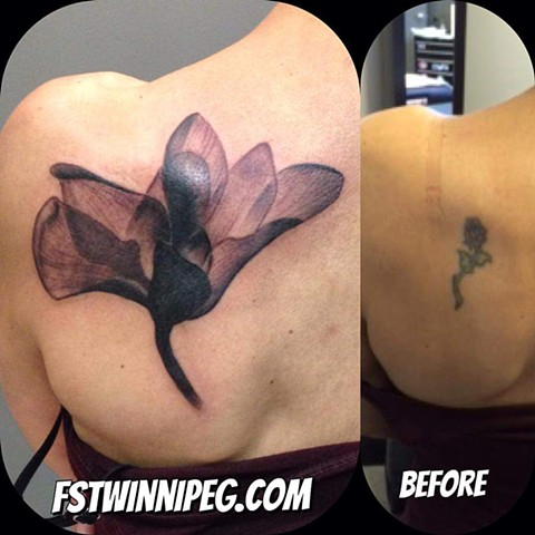Lotus coverup j Majury Winnipeg first string tattoo artist