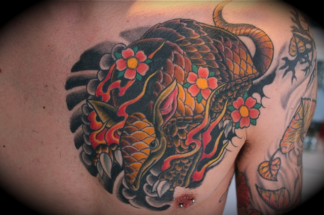 armadillo with blossoms tattoo