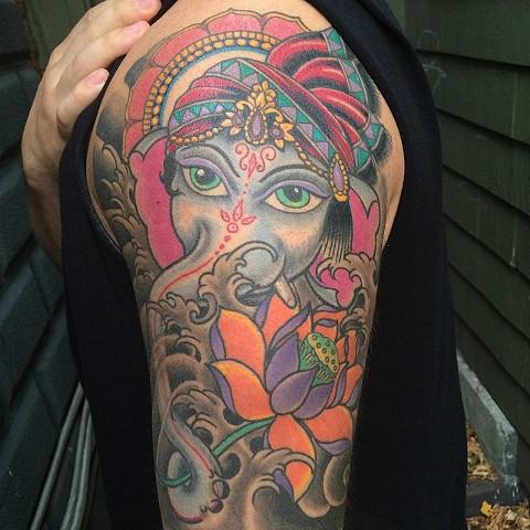 healed ganesh tattoo