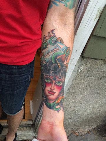 woman and ship tattoo