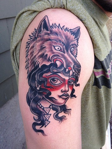 wolf head woman tattoo