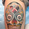 sugar skull skateboard tattoo