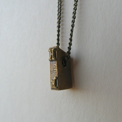 Strikeplate Necklace - K