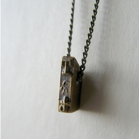 Strikeplate Necklace - T