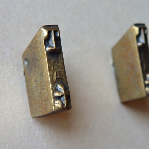 T Strikeplate Earrings