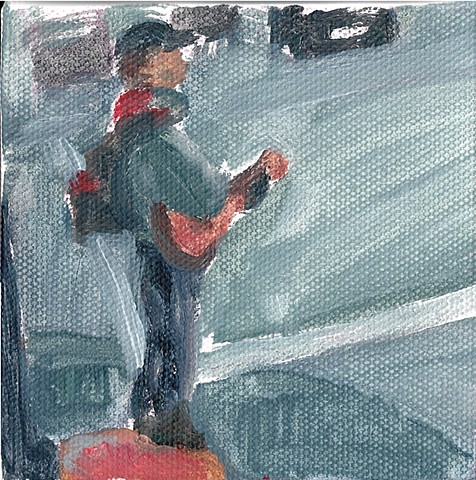 January 19  Man playing guitar on a street corner to unappreciative traffic.