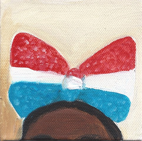 July 5 I don't know how this huge bow stayed on her head, but it was all part of the costume parade yesterday, July 4.