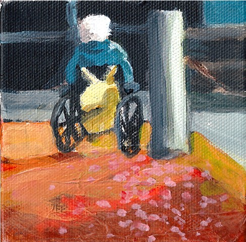 January 10  Old Man in wheelchair on a street corner.  Someone scattered rose petals behind.