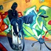 Cyclist and graffiti