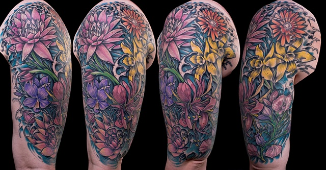 Floral daisy flower lily sweet pea color sleeve tattoo