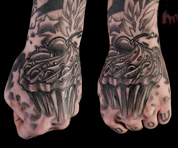 cupcake black and grey hand tattoo