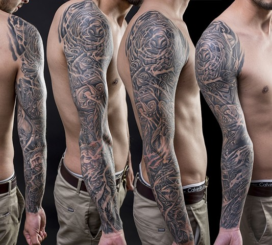 native american haida inspired full sleeve black and grey tattoo