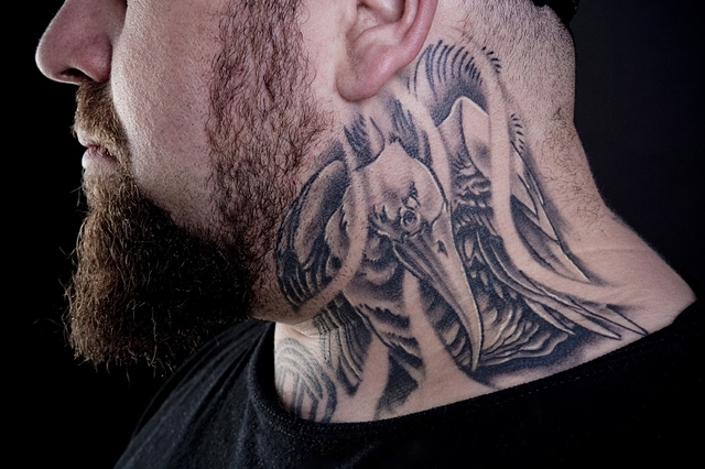 bird on the neck black and grey tattoo