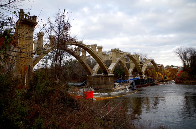 All arches exposed and ends coming down. From West bank downstream.