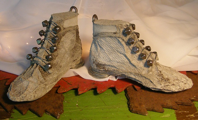 Textured Mud Nail Lace Ups with metal heels and pulls.