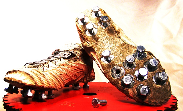 Abby'cleats metal spikes.  Home com. Lisa Sweeney mom