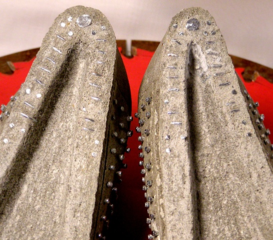 Thin Pins Lady shoes with stacked square nuts and wedge metal heels.