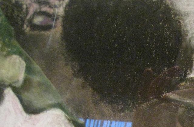 Black woman on sofa - detail