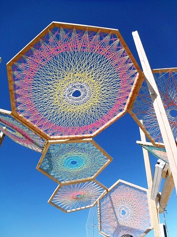 wood and yarn large scale mandala interactive installation community project for Mandala Sky Camp Burning Man 2011 by Eugenia Mitsanas, Sedonya Sedone, Magnus Schevene