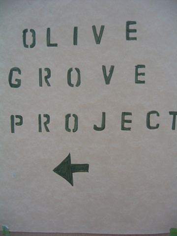 "sign for installation environment ""Olive Grove Project"" at Workspace Ltd. by Eugenia Mitsanas"