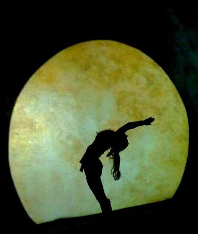 "Brandy Skipton-Harrington doing yoga in the moonrise animation in MFA graduate exhibition installation environment ""When the Barn Burns Down..."" by Eugenia Mitsanas"