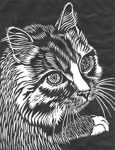 a woodcut of a cat's head and paw by Leslie Moore of PenPets