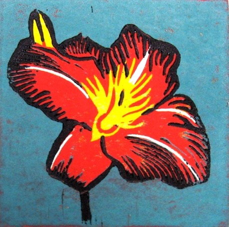 A linocut of a red lily by Leslie Moore of PenPets