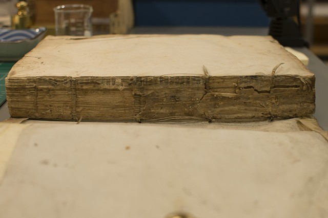 Limp vellum with broken support - Before