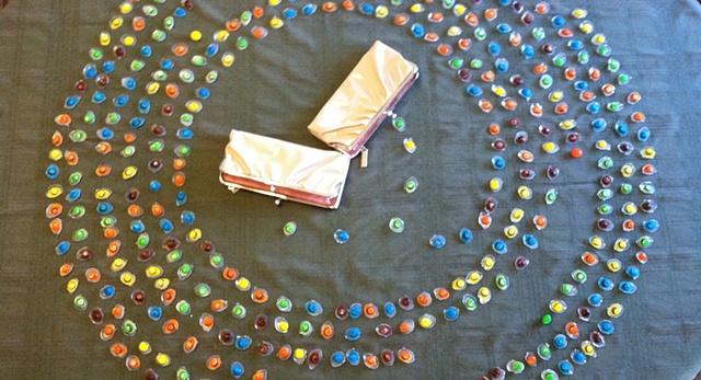 Pick clutch purses with circular M&M pattern